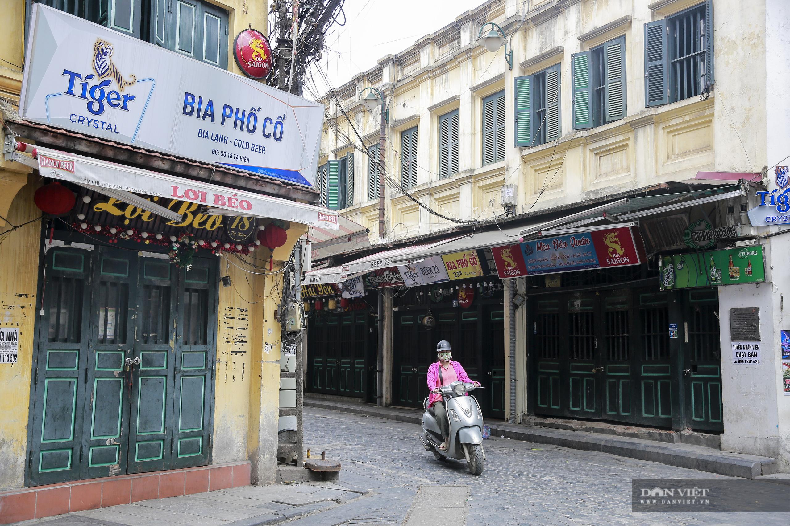 """Những phố ẩm thực """"không ngủ"""" tại Hà Nội đóng cửa hàng loạt vì Covid-19 - Ảnh 5."""