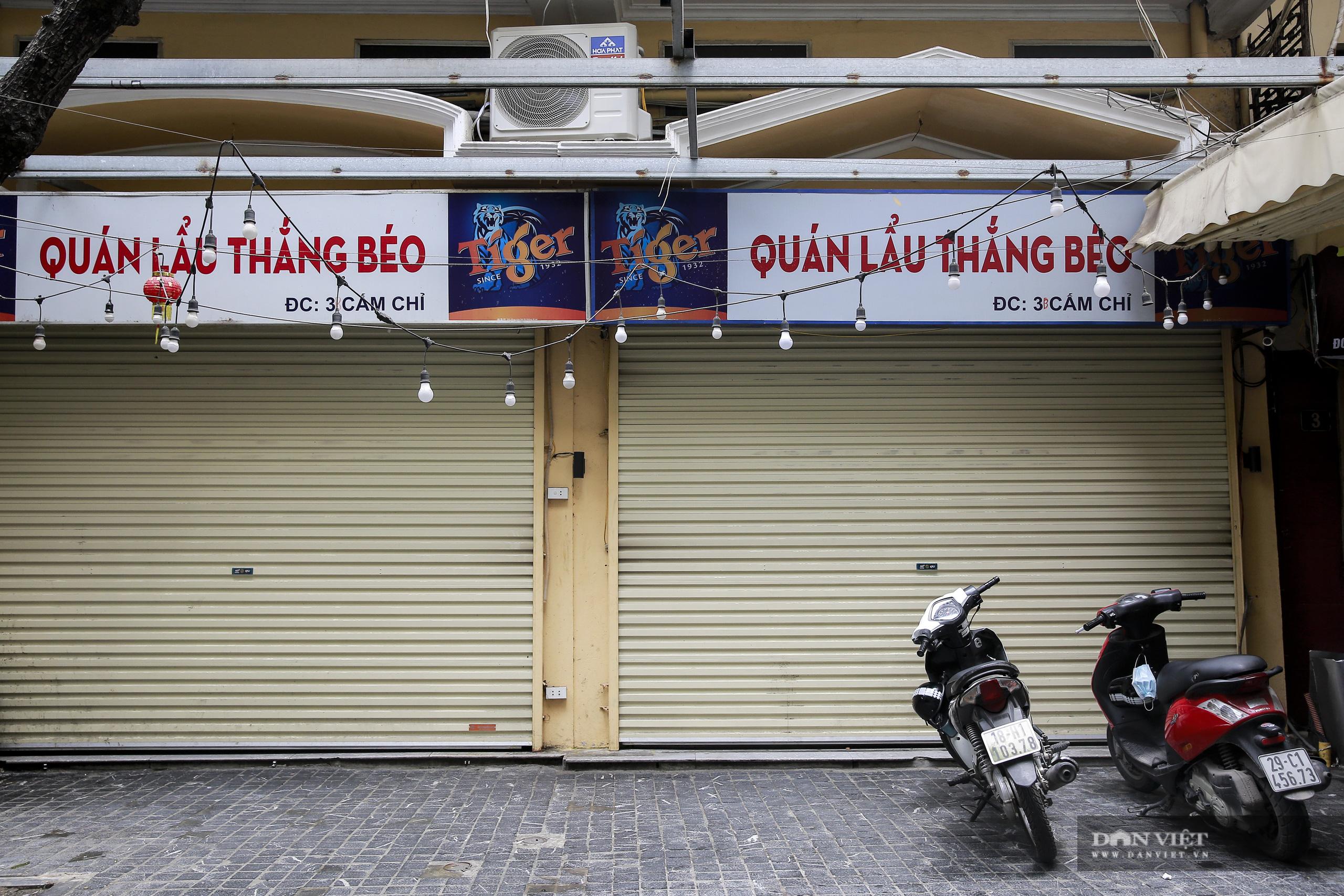 """Những phố ẩm thực """"không ngủ"""" tại Hà Nội đóng cửa hàng loạt vì Covid-19 - Ảnh 10."""