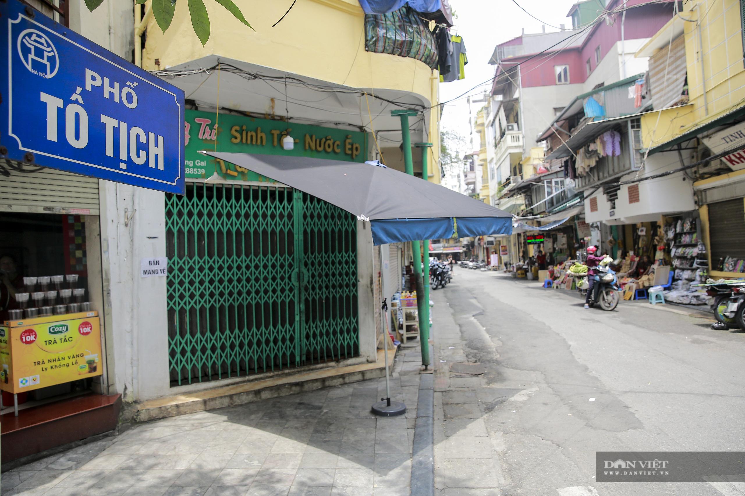"""Những phố ẩm thực """"không ngủ"""" tại Hà Nội đóng cửa hàng loạt vì Covid-19 - Ảnh 12."""