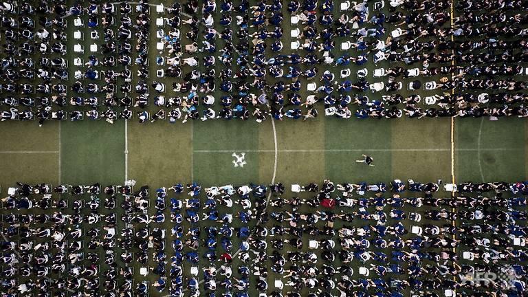 Lễ tốt nghiệp không khẩu trang của 11.000 sinh viên tại Vũ Hán - Ảnh 9.
