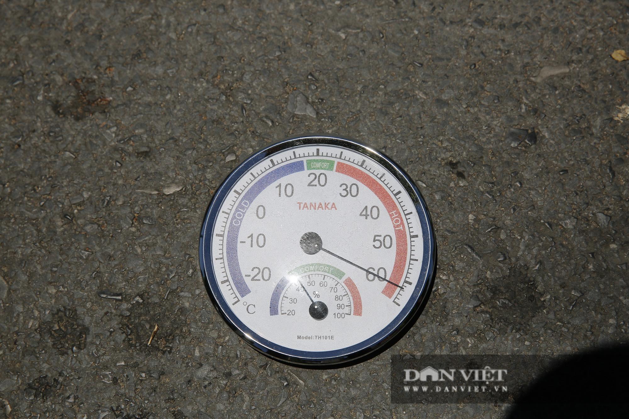 Hà Nội: Nhiệt độ mặt đường nóng hơn 60 độ C khiến ảo ảnh xuất hiện - Ảnh 2.