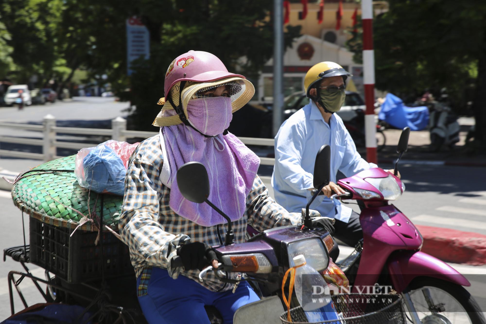 Hà Nội: Nhiệt độ mặt đường nóng hơn 60 độ C khiến ảo ảnh xuất hiện - Ảnh 4.