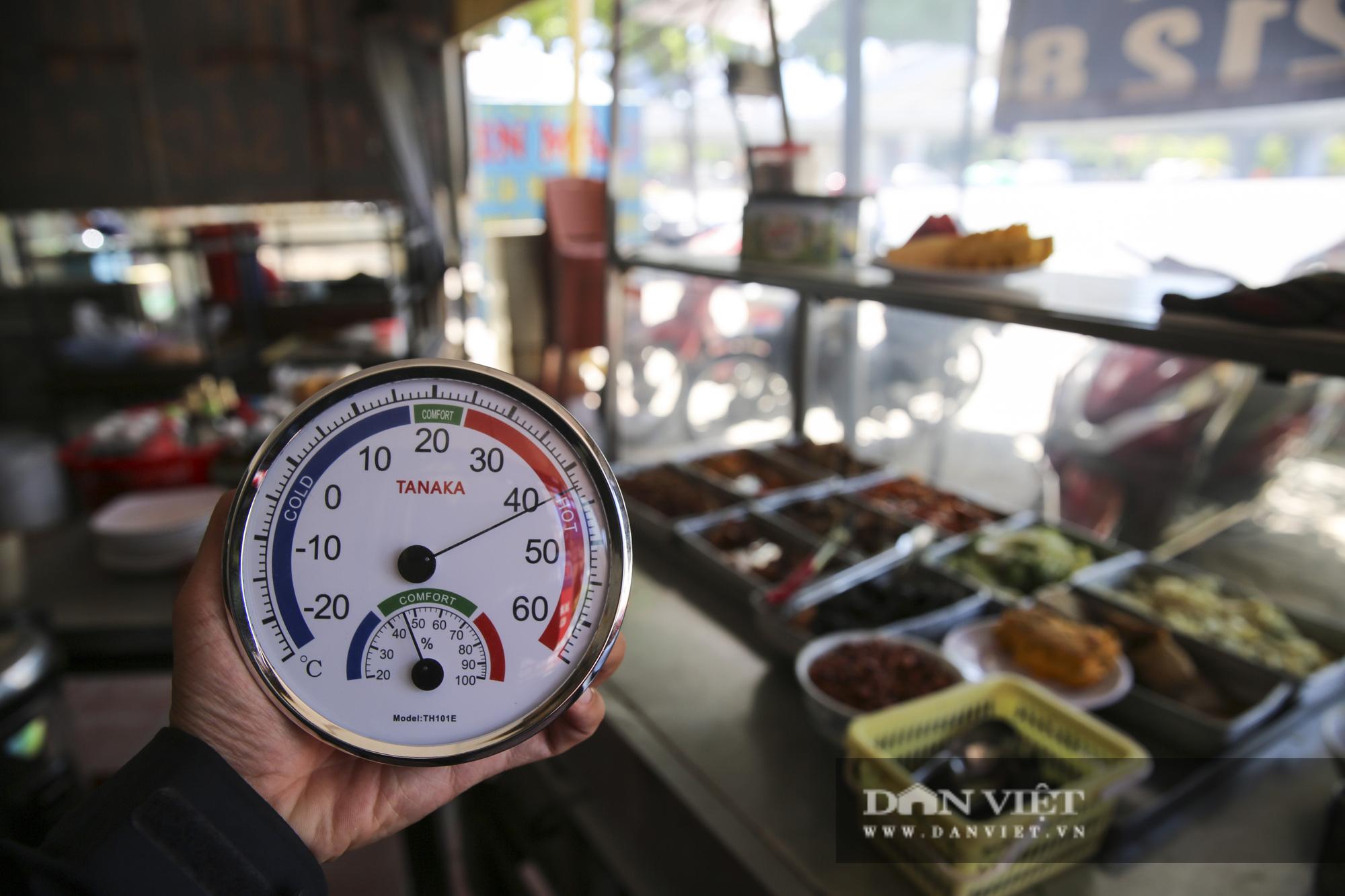 Hà Nội: Nhiệt độ mặt đường nóng hơn 60 độ C khiến ảo ảnh xuất hiện - Ảnh 6.