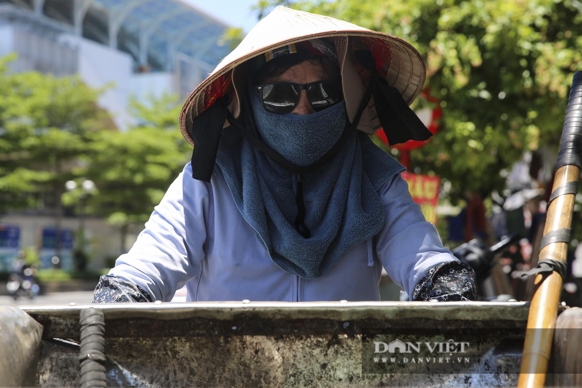 Hà Nội: Nhiệt độ mặt đường nóng hơn 60 độ C khiến ảo ảnh xuất hiện - Ảnh 9.