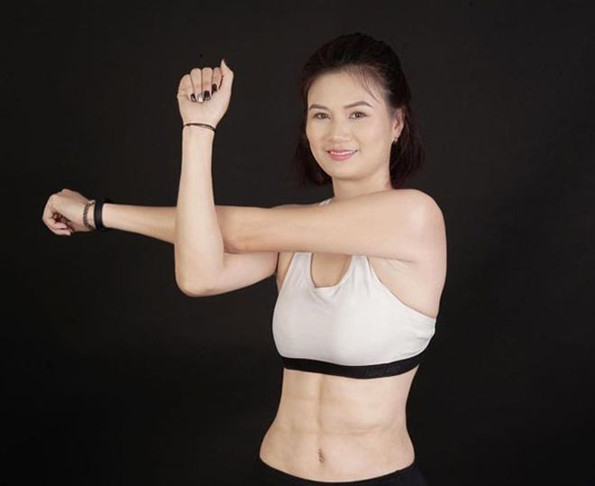 Hoa khôi bóng chuyền Kim Huệ U40: Những lần diện bikini khiến fan... nổi sóng - Ảnh 1.