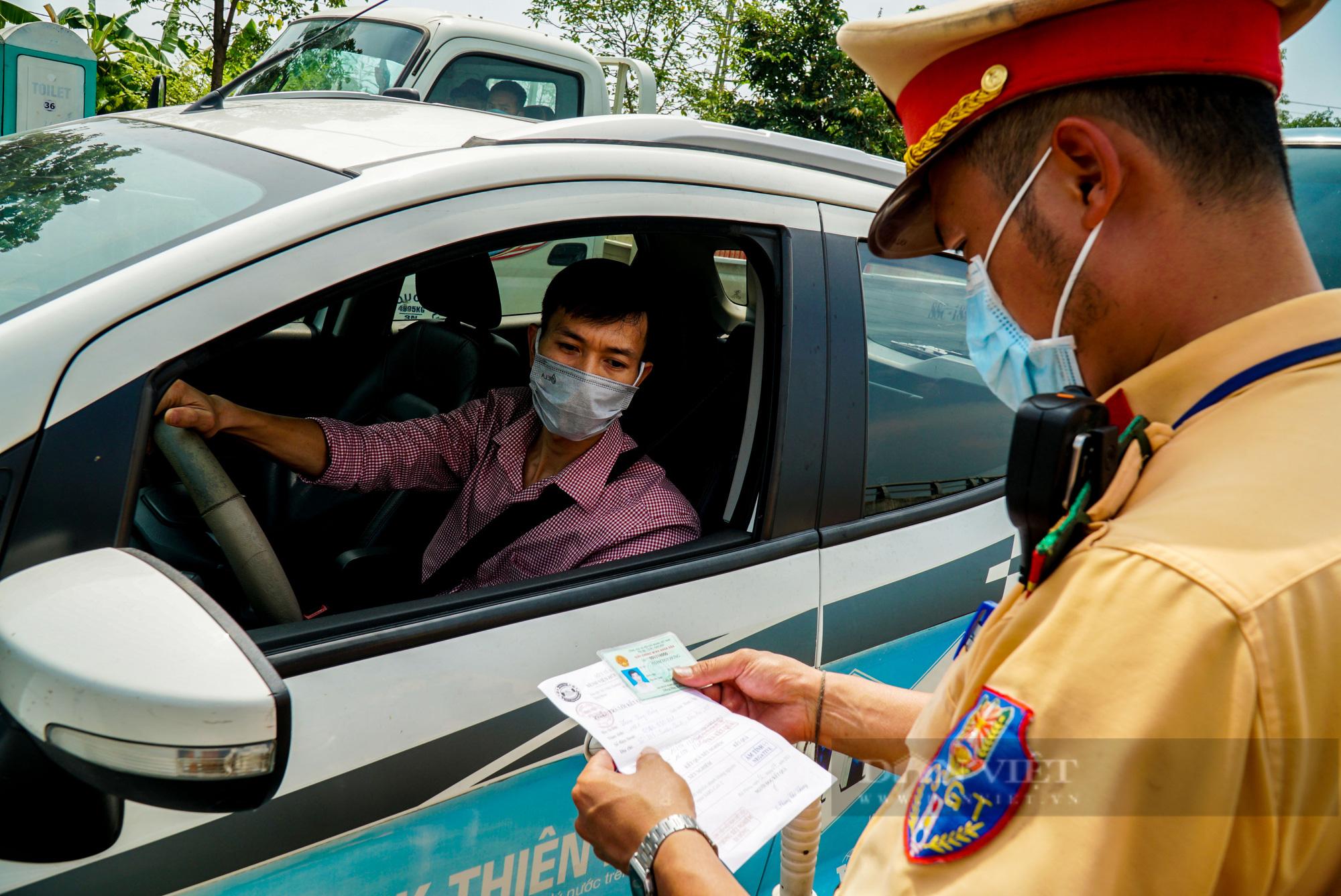 5 trường hợp đủ điều kiện được cấp giấy đi đường tại Hà Nội trong giãn cách xã hội - Ảnh 2.