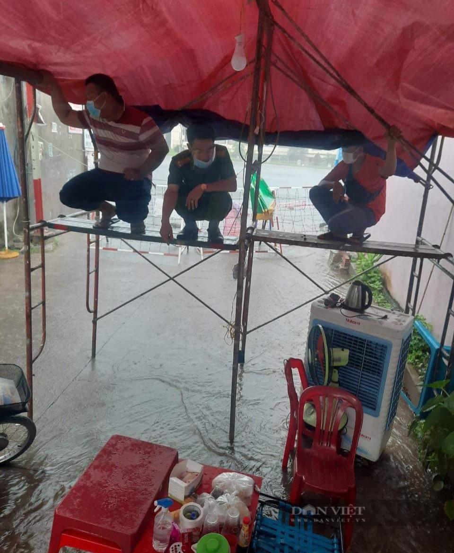 Đồng Nai: Chốt kiểm soát dịch những ngày mưa - Ảnh 2.