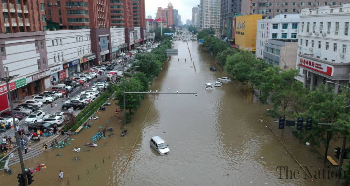 Lũ lụt kinh hoàng ở Trung Quốc khiến 33 người thiệt mạng, 3 triệu người nằm trong vùng nguy hiểm - Ảnh 1.