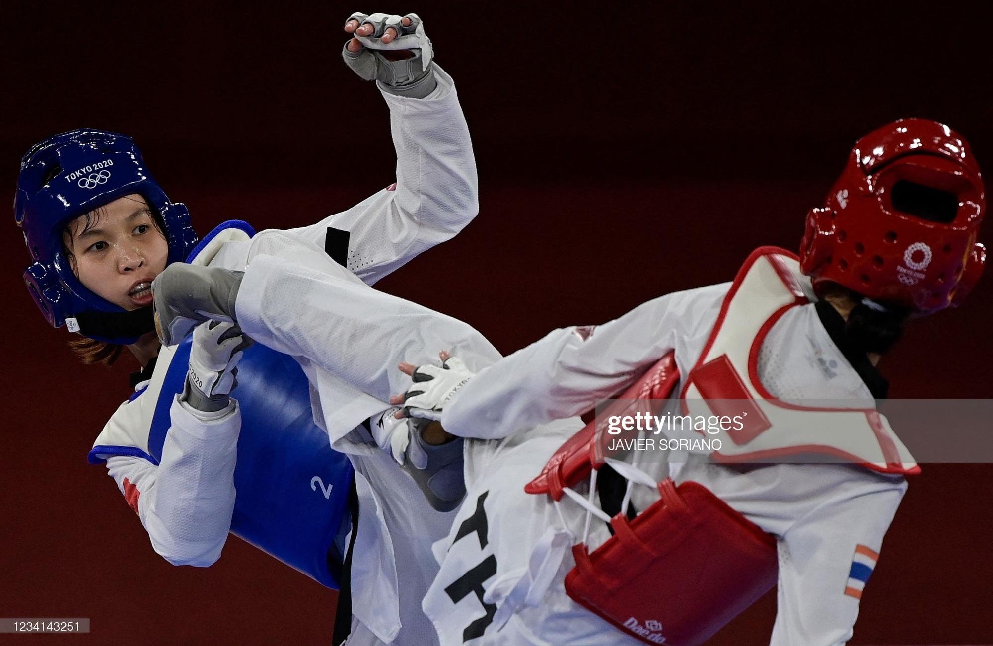 HLV ĐT Taekwondo Việt Nam nói gì khi Trương Thị Kim Tuyền thua võ sĩ Thái Lan? - Ảnh 1.