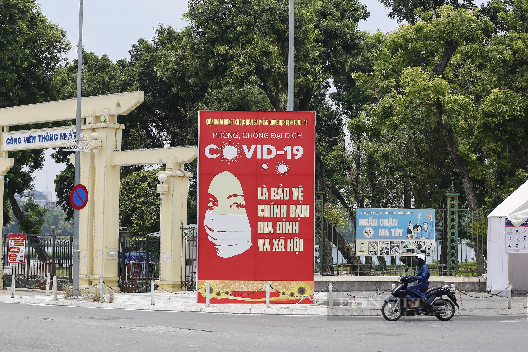 Đường phố Hà Nội xuất hiện những thông điệp tiếp thêm sức mạnh trong công tác phòng, chống Covid-19  - Ảnh 1.