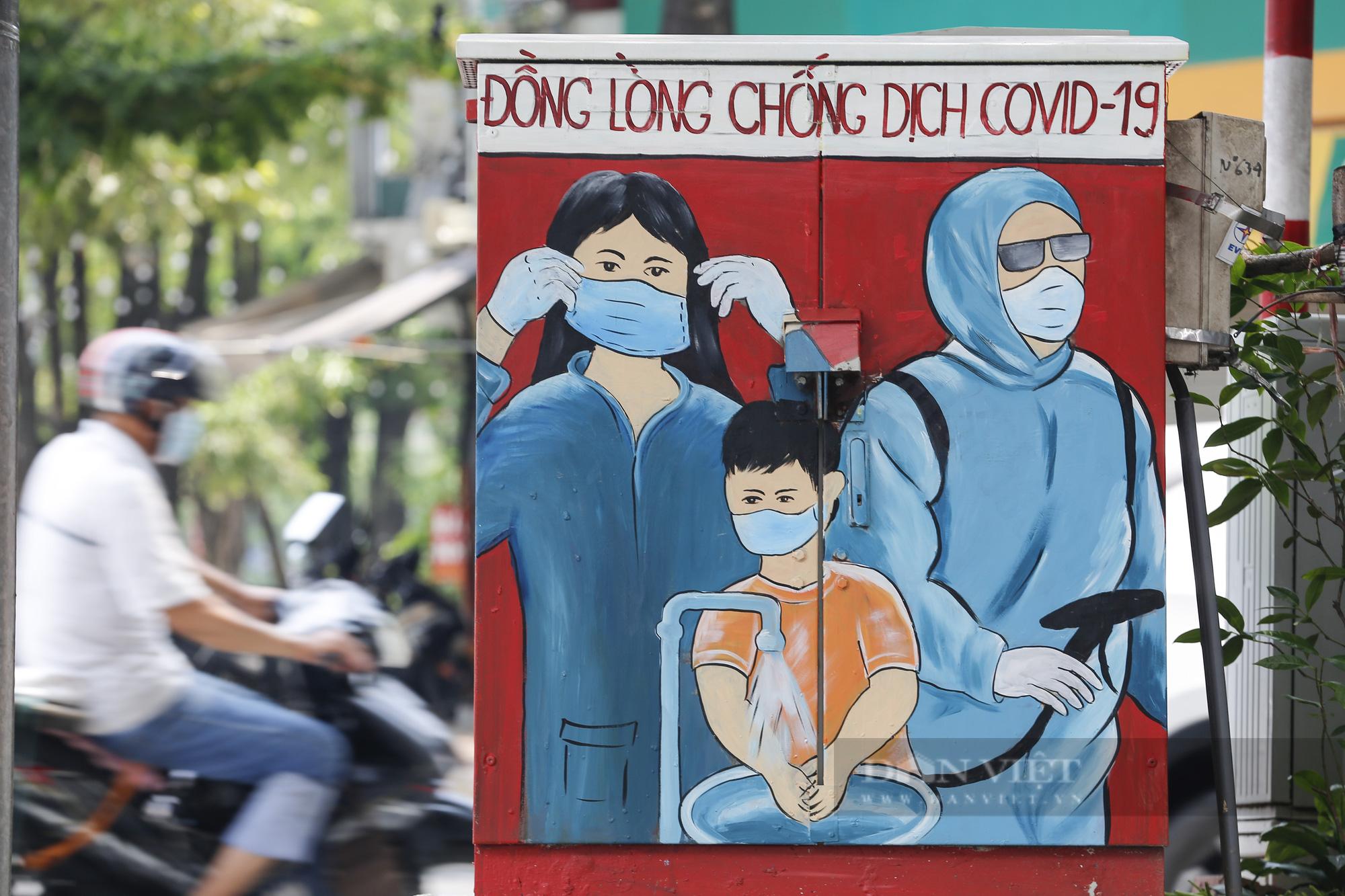 Đường phố Hà Nội xuất hiện những thông điệp tiếp thêm sức mạnh trong công tác phòng, chống Covid-19  - Ảnh 3.