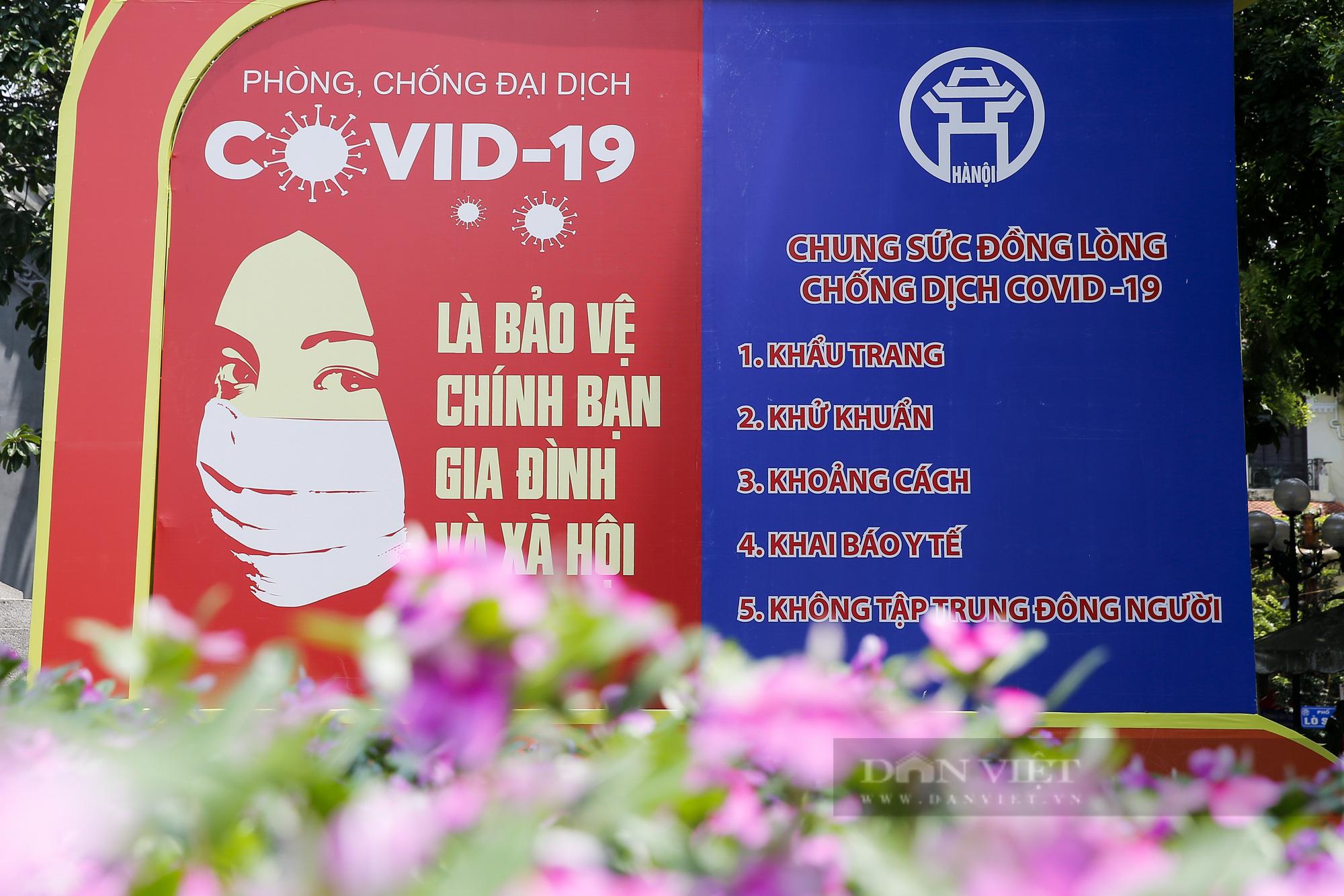 Đường phố Hà Nội xuất hiện những thông điệp tiếp thêm sức mạnh trong công tác phòng, chống Covid-19  - Ảnh 5.