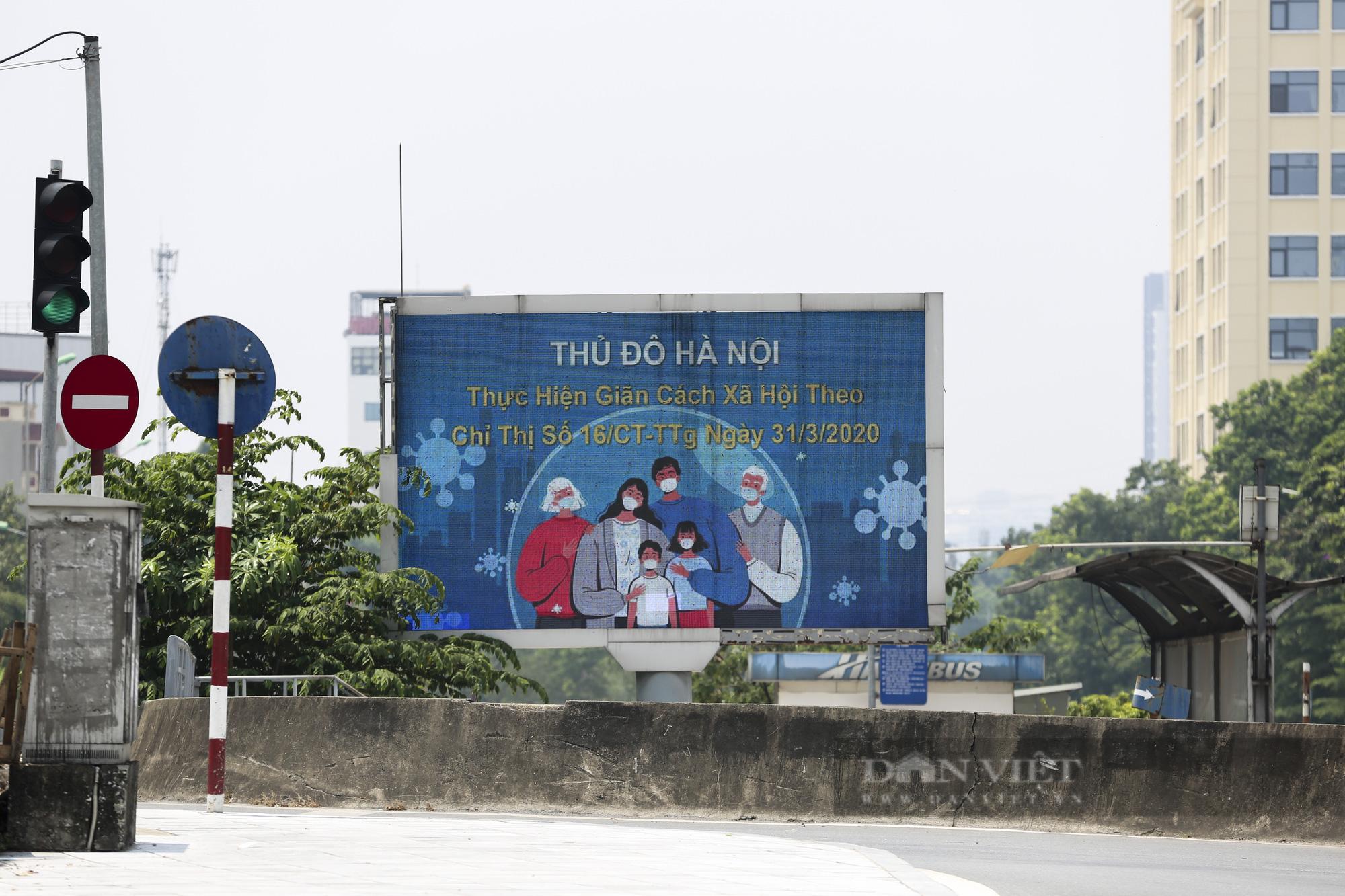 Đường phố Hà Nội xuất hiện những thông điệp tiếp thêm sức mạnh trong công tác phòng, chống Covid-19  - Ảnh 11.