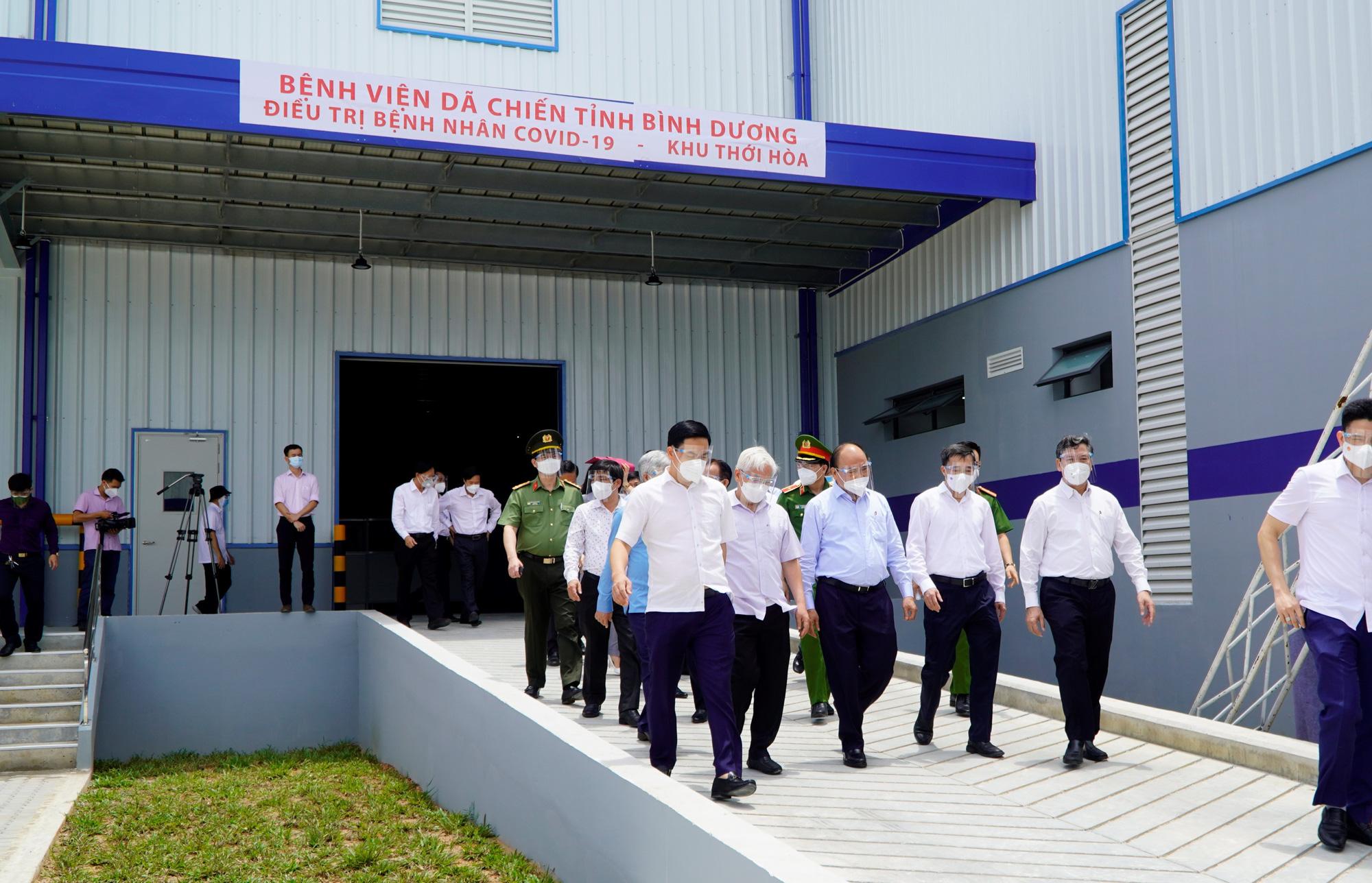 Chủ tịch nước Nguyễn Xuân Phúc: Bình Dương không được để người dân thiếu đói - Ảnh 1.