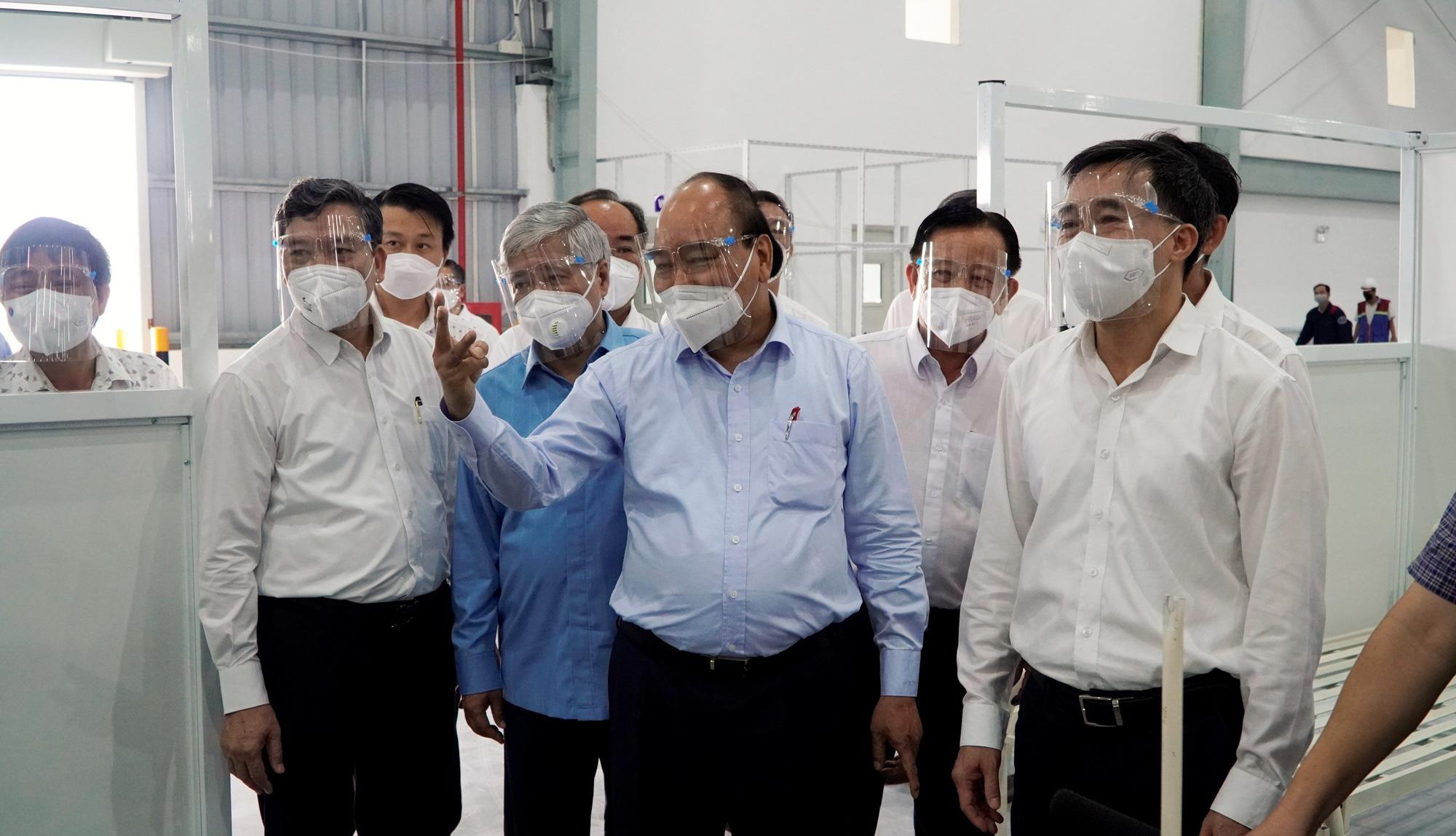 Chủ tịch nước Nguyễn Xuân Phúc: Bình Dương không được để người dân thiếu đói - Ảnh 2.