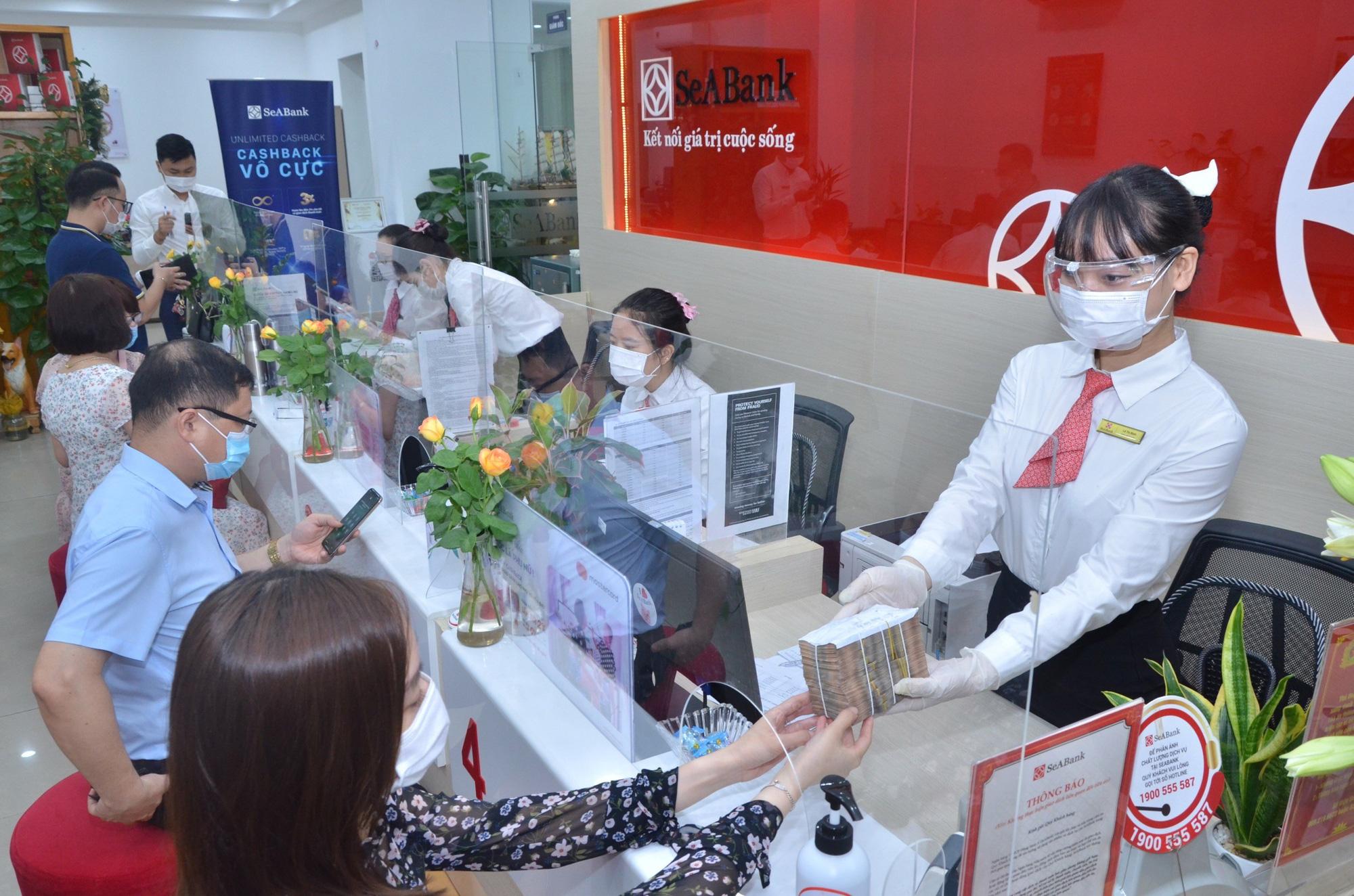 SeABank giảm lãi suất tối đa 1%/năm cho khách hàng ảnh hưởng bởi dịch Covid-19 - Ảnh 1.