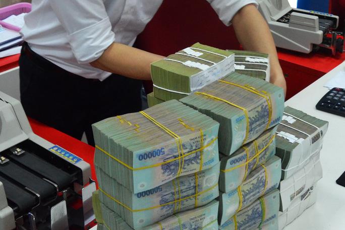 TS Lê Xuân Nghĩa nêu lý do lãi suất tiết kiệm sẽ neo cao tại các ngân hàng nhỏ - Ảnh 3.