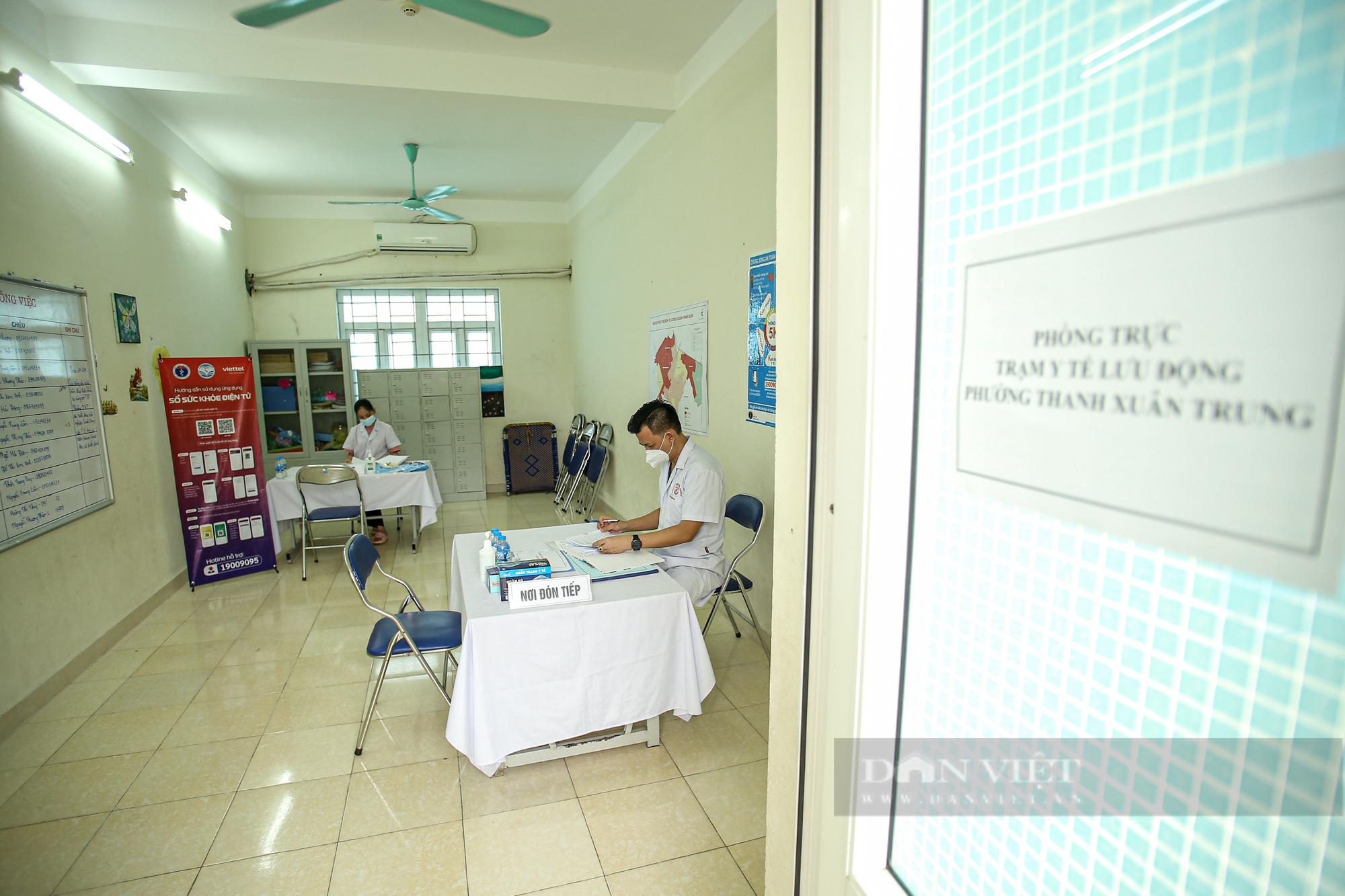 Hiệu quả từ 11 trạm y tế lưu động: Đảm bảo y tế không bị đứt gãy trong giãn cách xã hội - Ảnh 1.