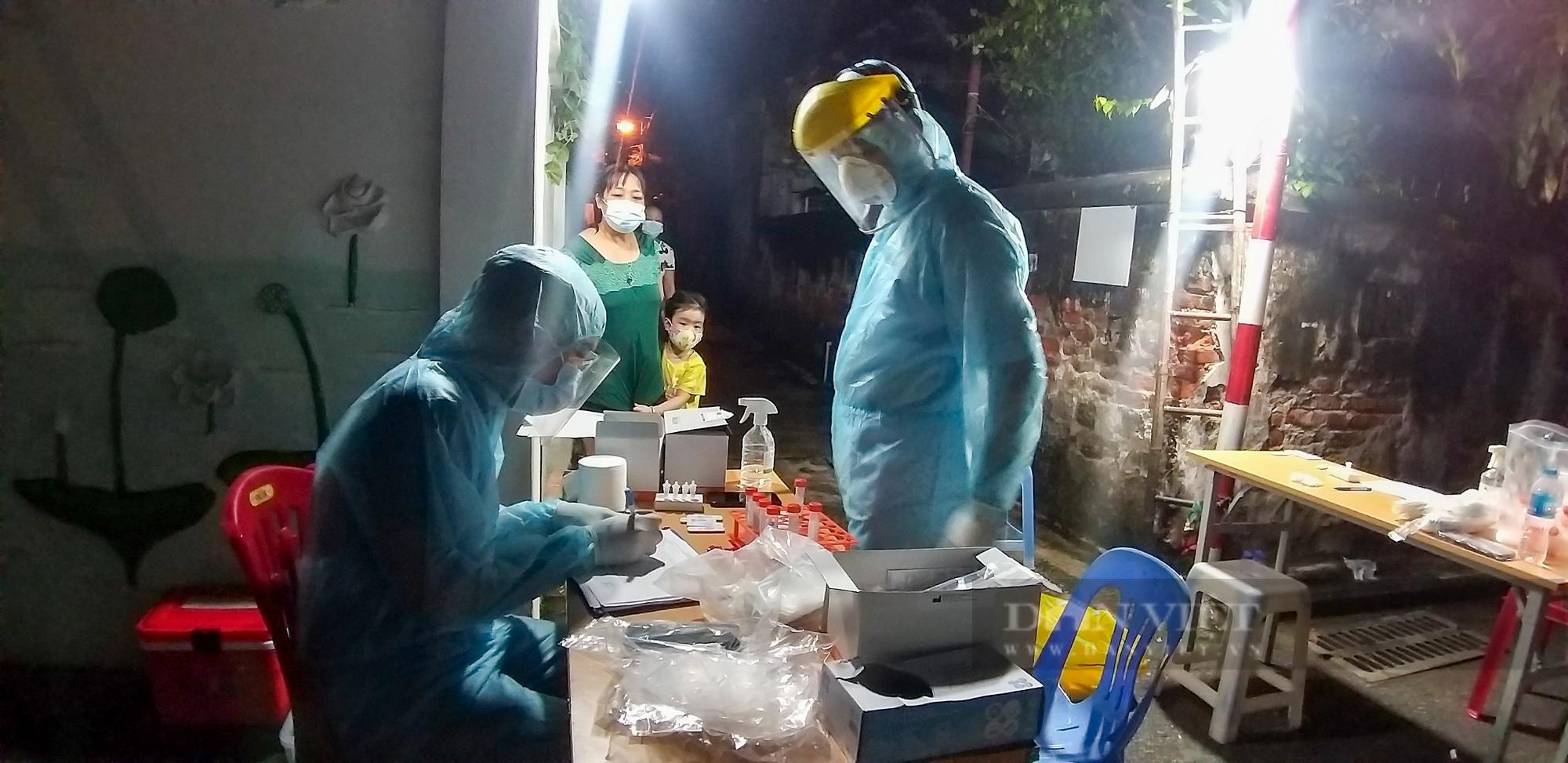 """Hà Nội: Phong tỏa, truy vết f1 thuộc chùm 6 ca dương tính SARS-CoV-2 trong """"vùng xanh"""" - Ảnh 5."""