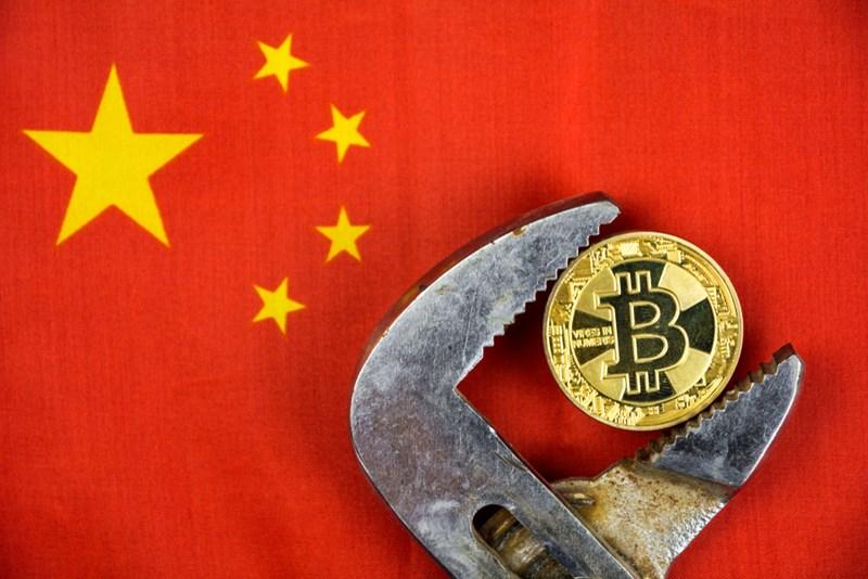 Cơ quan quản lý mạng ở tỉnh Hà Bắc phía bắc Trung Quốc vừa cho biết, họ sẽ hợp tác với các cơ quan chính phủ để trấn áp hoạt động khai thác và kinh doanh tiền ảo. Ảnh: @AFP.