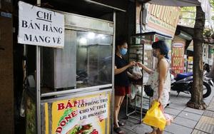 """Dịch Covid-19 diễn biến phức tạp, đường phố Hà Nội ngập tràn biển hiệu """"chỉ bán mang về"""""""