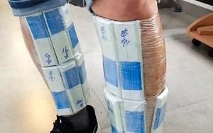 Một người Trung Quốc buôn lậu Intel Core trăm ngàn đô, quấn quanh người