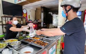 Hà Nội: Cảnh thưa thớt khách ở các hàng quán bán mang về trong ngày đầu mở cửa trở lại