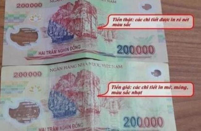 Ngân hàng Nhà nước khuyến cáo người tiêu dùng kiểm tra đồng tiền khi giao dịch tiền mặt - Ảnh 1.
