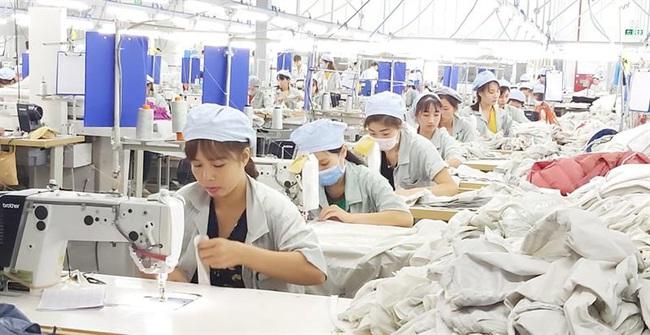 Hàng vạn công nhân vào guồng sản xuất sau kỳ nghỉ Tết - Ảnh 3.