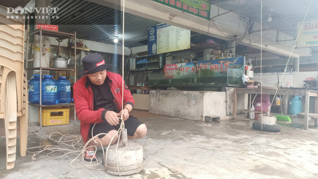 Hà Tĩnh: Di dời dân, chằng chéo nhà cửa trước cơn bão số 13 - Ảnh 2.
