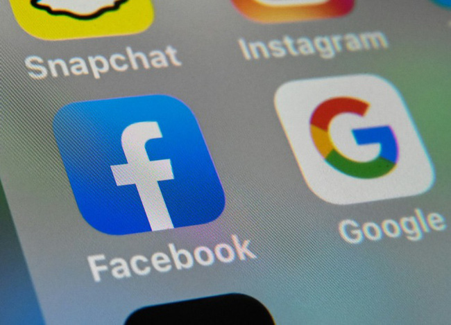 Tiền quảng cáo từ vi phạm bản quyền báo chí về tay Facebook và Google, các nước quản lý thế nào? - Ảnh 1.