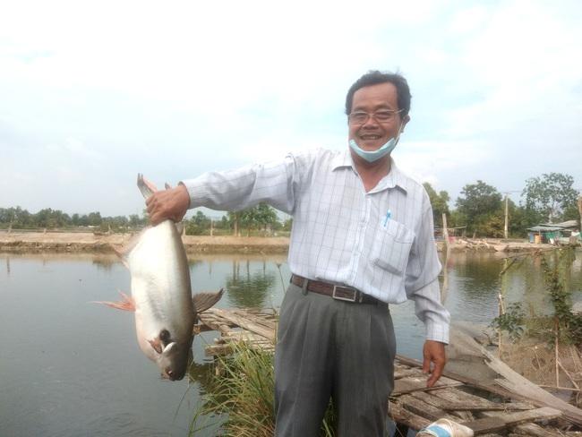 Xóm nghèo đổi đời nhờ con cá tra - Ảnh 3.