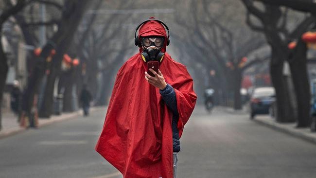 Dow Jones tụt 123 điểm khi nhà đầu tư chưa thoát khỏi nỗi sợ hãi dịch virus corona - Ảnh 1.