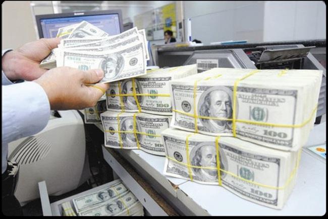 Tỷ giá ngoại tệ hôm nay 26/3 lại tăng vù vù - Ảnh 1.