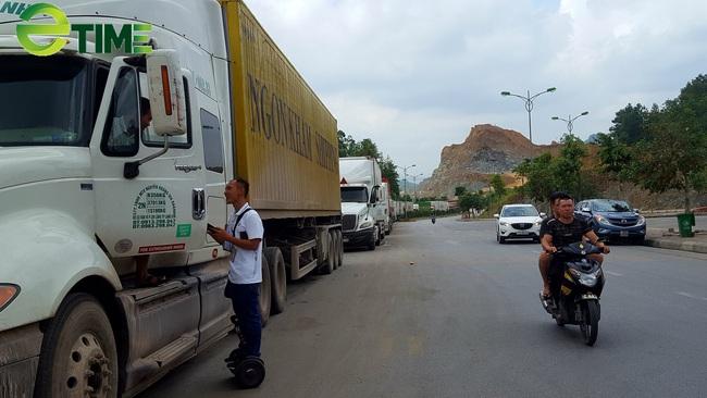 Lạng Sơn: Tạm dừng thông quan hàng hóa xuất khẩu, tái xuất qua lối mở Co Sa - Ảnh 1.