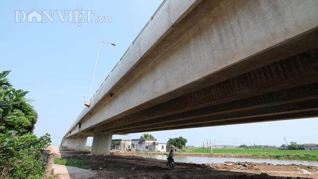Cận cảnh cầu Thịnh Long nối đôi bờ sông Ninh Cơ trước ngày thông xe - Ảnh 8.
