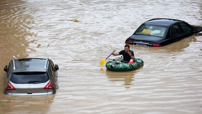 Mưa lớn không ngừng, đập Tam Hiệp bất lực để ngăn lũ ở sông Dương Tử - Ảnh 1.