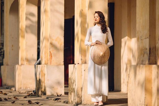 Ngẩn ngơ trước vẻ xinh đẹp của chuyền hai Nguyễn Thu Hoài trong tà áo dài - Ảnh 15.