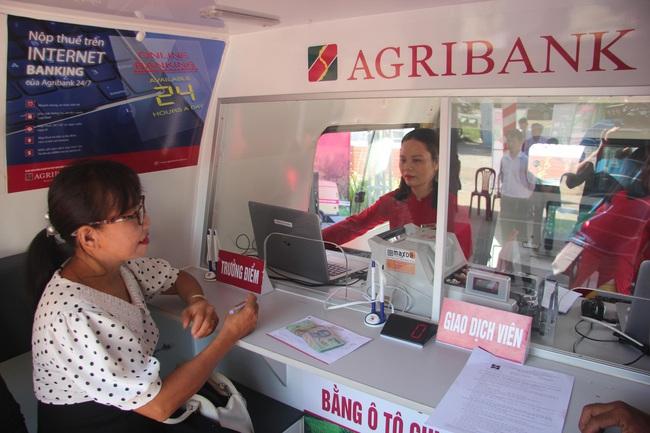 Agribank Phú Yên: Khai trương điểm giao dịch lưu động bằng ô tô chuyên dùng tại xã Ea Chà Rang - Ảnh 2.