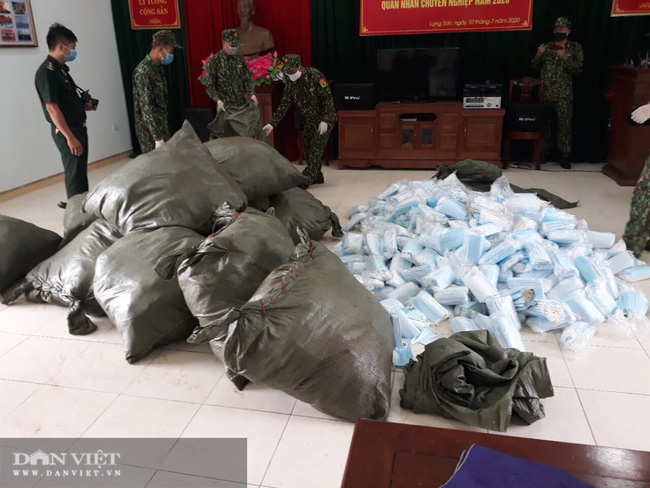 Lạng Sơn: 1 đêm bắt giữ 450 kg nầm lợn và hàng nghìn khẩu trang  - Ảnh 2.