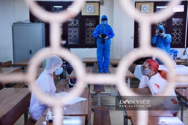 Người Hà Nội từ Đà Nẵng trở về đi xét nghiệm PCR - Ảnh 3.