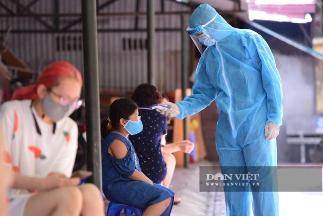 Người Hà Nội từ Đà Nẵng trở về đi xét nghiệm PCR - Ảnh 5.