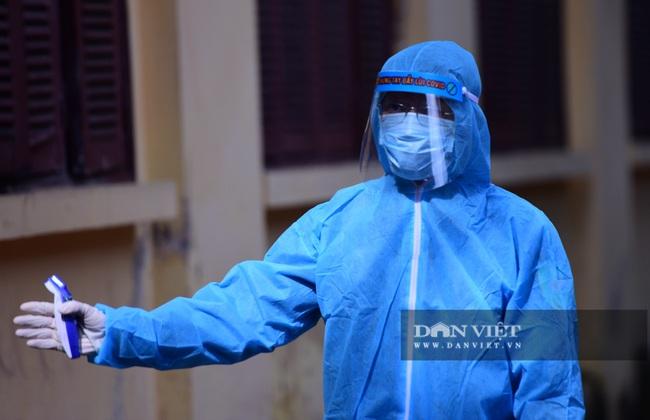 Người Hà Nội từ Đà Nẵng trở về đi xét nghiệm PCR - Ảnh 9.
