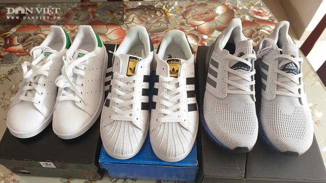 Bình Dương: Phát hiện, tịch thu hàng ngàn đôi giày nhái hàng hiệu Adidas, Nike, Gucci… - Ảnh 6.