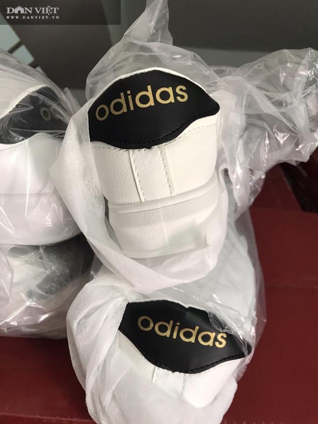 Bình Dương: Phát hiện, tịch thu hàng ngàn đôi giày nhái hàng hiệu Adidas, Nike, Gucci… - Ảnh 7.