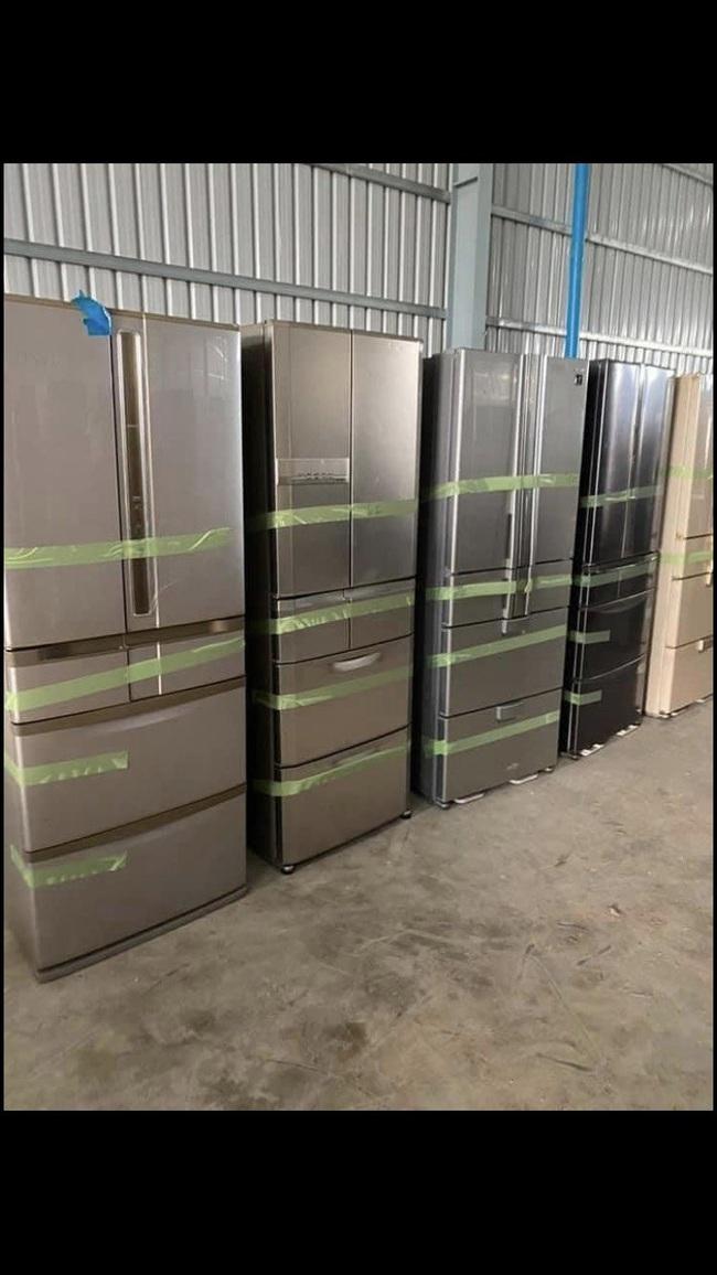"""Đột kích kho """"phù phép"""" biến tủ lạnh, máy lọc không khí cũ thành mới """"keng"""" rồi bán ra thị trường - Ảnh 1."""