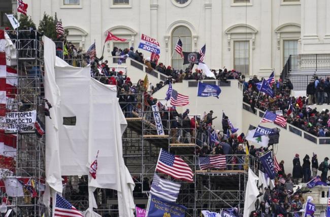 Lộ diện nhóm giật dây cuộc bạo loạn tại Quốc hội Mỹ - Ảnh 1.