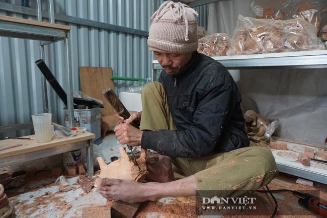 Hà Nội: Trâu gỗ giá tiền triệu cháy hàng dịp cận Tết, bán đàn trâu 300 con thu về ngay 500 triệu đồng - Ảnh 1.