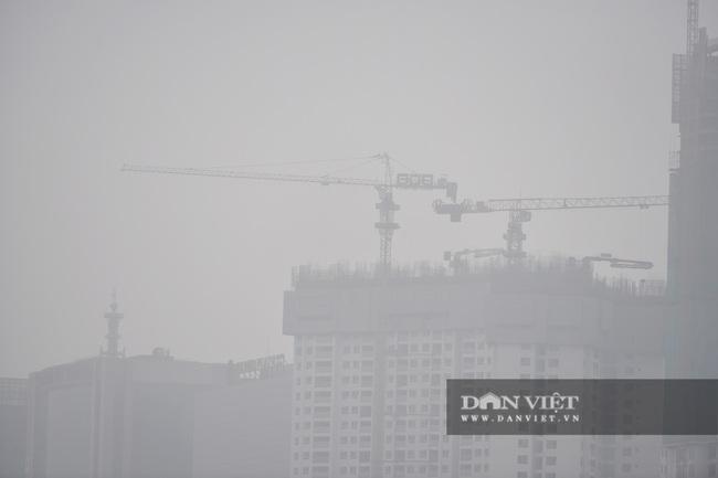 Hà Nội sương mù như Sa Pa, nhiều ôtô phải bật đèn đi giữa ban ngày - Ảnh 13.