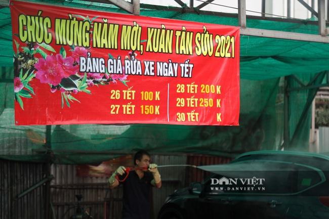 30 Tết tranh thủ ở Hà Nội rửa xe kiếm 30 triệu đồng - Ảnh 3.